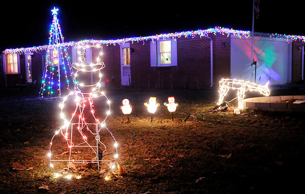 Don Knight | The Herald Bulletin<br /> Faye and Greg Jackson have their home decorated at the intersection of Leland and Larita off County Road 100 South.