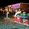 Don Knight | The Herald Bulletin<br /> Jerry Palmer has been decorating his home at 1705 Bittersweet Dr. since 1975 and his collection includes a train that runs on a track he fashioned himself after the original wore out.