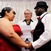 Don Knight | The Herald Bulletin<br /> Judge Thomas Newman Jr. presided over 10 weddings during Hoosier Parks New Year's Eve festivities on Saturday.