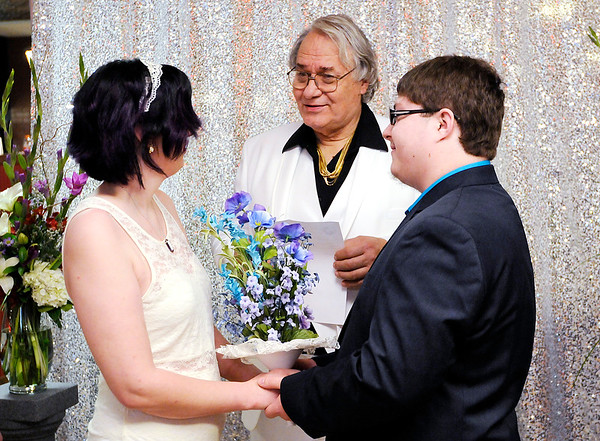 Don Knight   The Herald Bulletin<br /> Judge Thomas Newman Jr. presided over 10 weddings during Hoosier Parks New Year's Eve festivities on Saturday.