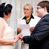 Don Knight | The Herald Bulletin<br /> Brittany Goetzke puts a ring on Justin Trent's finger as the two were married by Judge Thomas Newman Jr. during Hoosier Parks' New Year's Eve festivities on Saturday. Goetzke and Trent traveled from Kokomo to tie the not.