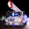Don Knight |  The Herald Bulletin<br /> Anderson's Light and Power covered one of their trucks with Christmas lights and had Olaf riding shotgun during the Anderson Christmas parade on Saturday.