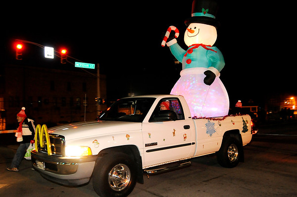 Don Knight |  The Herald Bulletin<br /> A large inflatable snowman was part of the McDonald's entry in the Anderson Christmas parade on Saturday.