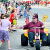 John P. Cleary |  The Herald Bulletin<br /> A member of the Murat Desert Patrol gives high-fives to the crowd during the Anderson's Independence Day Parade.
