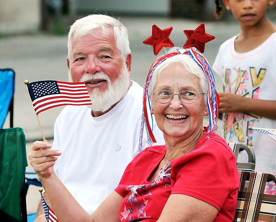 John P. Cleary |  The Herald Bulletin<br /> Parade goers show their patriotic spirit at the Anderson Independence Day Parade.