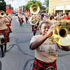 John P. Cleary |  The Herald Bulletin<br /> Anderson High School's Marching Highlanders parade down Main Street during Anderson's Independence Day Parade Monday evening.
