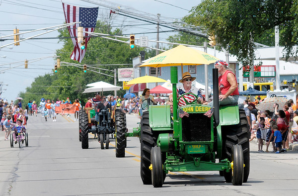 Don Knight | The Herald Bulletin<br /> A 1935 John Deere D tractor owned by Mike and Nancy Retherford takes part in the Chesterfield Independence Day Parade on Tuesday.