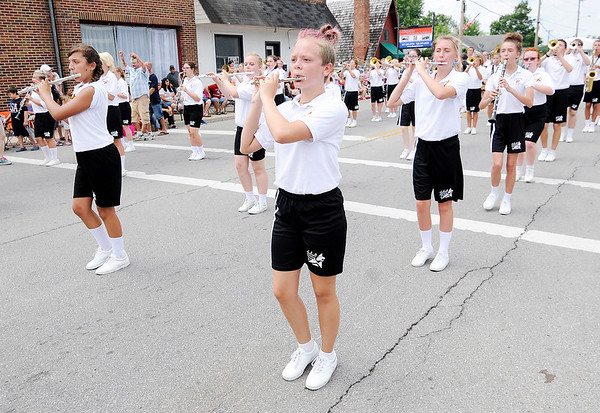Don Knight | The Herald Bulletin<br /> The Alexandria-Monroe Marching Tigers march in the Chesterfield Independence Day Parade on Tuesday.
