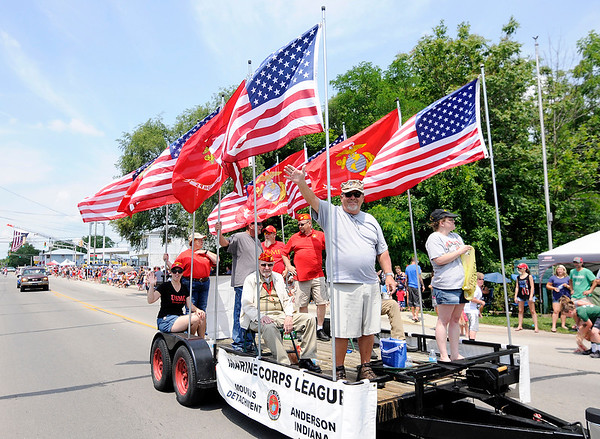 Don Knight | The Herald Bulletin<br /> Members of the Marine Corps League Mounds Detachment ride in the Chesterfield Independence Day Parade on Tuesday.