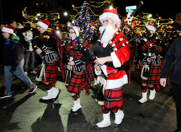 Don Knight   The Herald Bulletin<br /> The Anderson High School Marching Highlanders bag pipers march in the city of Anderson's Christmas Parade on Saturday.