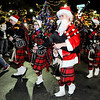 Don Knight | The Herald Bulletin<br /> The Anderson High School Marching Highlanders bag pipers march in the city of Anderson's Christmas Parade on Saturday.