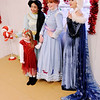 Don Knight | The Herald Bulletin<br /> Madison Sale, 4, poses for a photo with princesses from Once Upon a Princess during Anderson's Christmas Celebration on Saturday.