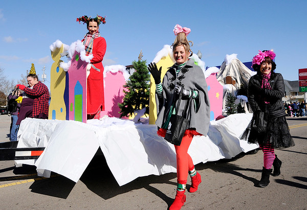 Don Knight | The Herald Bulletin<br /> The float from The Real Estate Pros of Keller Williams is decorated in the theme of the Grinch during Christmas in Pendleton on Saturday.