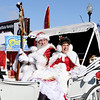 Don Knight | The Herald Bulletin<br /> Santa and Mrs. Claus ride in a carriage during the Christmas in Pendleton parade on Saturday.