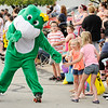 Don Knight | The Herald Bulletin<br /> Anderson Roll Arena's roller skating frog greets spectators during Anderson's Independence Parade on Wednesday.