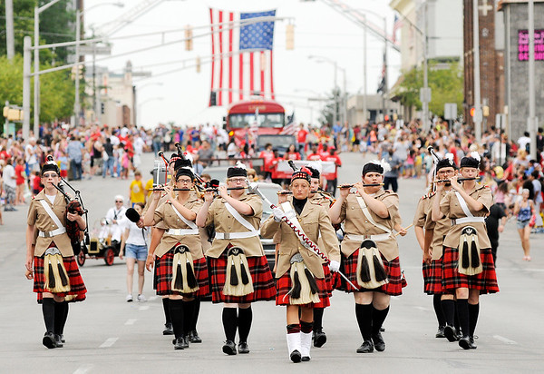 Don Knight | The Herald Bulletin<br /> The Anderson High School's new Pipe and Drums ensemble marches in Anderson's Independence Parade on Wednesday. View a gallery of photos from the parade online at photos.heraldbulletin.com.