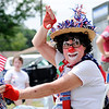 Don Knight | The Herald Bulletin<br /> Patches the clown waves during Chesterfield's Independence Day Parade on Thursday.