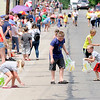 Don Knight | The Herald Bulletin<br /> Kids collect candy during Chesterfield's Independence Day Parade on Thursday.