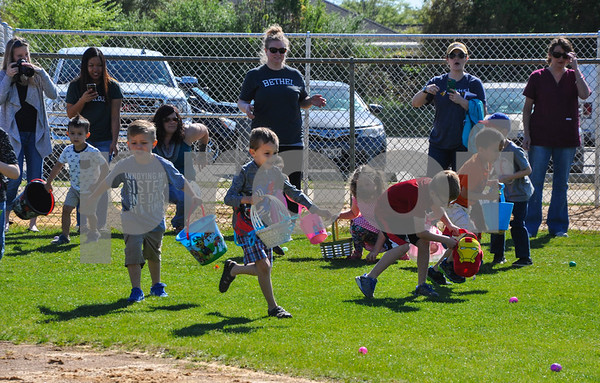 Children race to gather eggs at the Third Annual Whitehouse Community Easter Egg Hunt. The event was held at the Whitehouse Sports Complex on Saturday, March 31. (Jessica T. Payne/Tyler Paper)