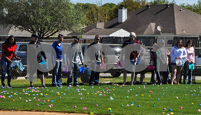 The Third Annual Whitehouse Community Easter Egg Hunt wasn't just for children. Adults line the fence at the Whitehouse Sports Complex on Saturday, March 31 as they get ready to join in on the fun. (Jessica T. Payne/Tyler Paper)
