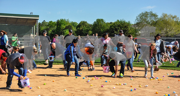 Parents rush the field at the Third Annual Whitehouse Community Easter Egg Hunt for a chance to win up to $200 inside selected eggs. The event was held at the Whitehouse Sports Complex on Saturday, March 31. (Jessica T. Payne/Tyler Paper)
