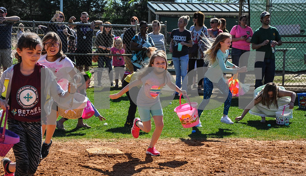 Children rush the baseball fields at the Whitehouse Sports Complex during the Third Annual Whitehouse Community Easter Egg Hunt. The event was held on Saturday, March 31. (Jessica T. Payne/Tyler Paper)