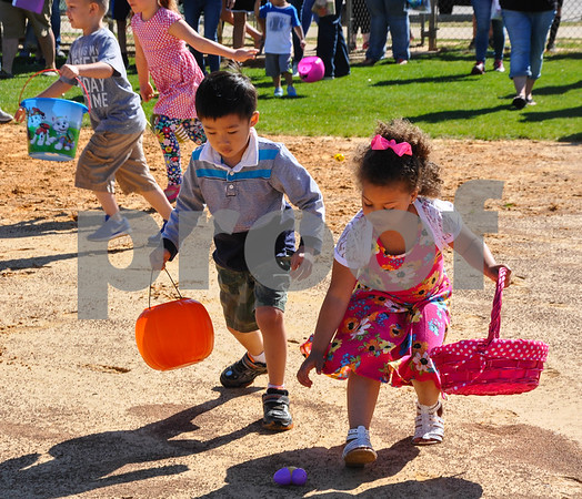 A young boy and girl rush to grab an Easter egg at the Third Annual Whitehouse Community Easter Egg Hunt on Saturday, March 31. (Jessica T. Payne/Tyler Paper)