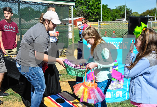 A young girl wins candy after playing a game at the Third Annual Whitehouse Community Easter Egg Hunt. The event was held at the Whitehouse Sports Complex on Saturday, March 31. (Jessica T. Payne/Tyler Paper)