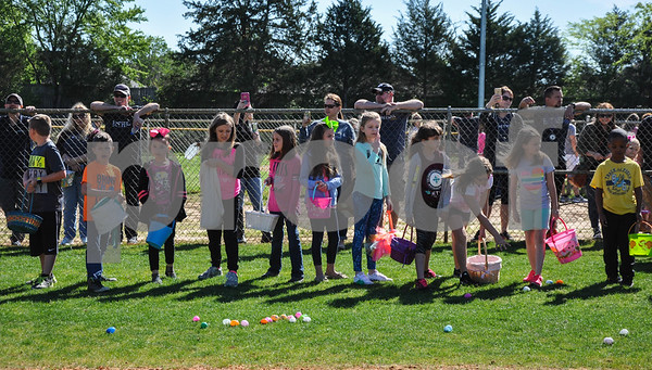 Children line the fence at the Whitehouse Sports Complex as they wait to start the Third Annual Whitehouse Community Easter Egg Hunt. The event was held on Saturday, March 31.  (Jessica T. Payne/Tyler Paper)