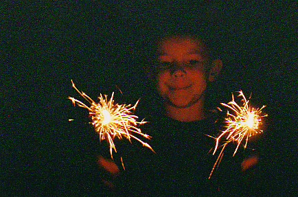 Lucas overcame his fear of loud noises to join in the fun this year! 2005