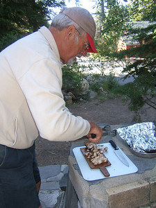 Dad cutting up his BBQ'd chicken.