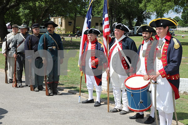Sons of The American Revolution stand ready at the Tyler Veterans Memorial Day Service at Tyler Memorial Park Cemetery.
