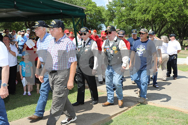 Active and retired veterans of all ages and branches marching in to the Tyler Memorial Park Cemetery for the Tyler Veterans Memorial Day Services.