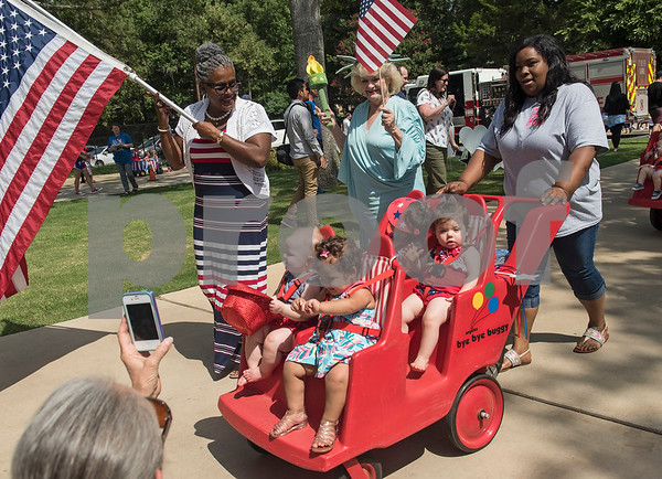 Infants ride in a stroller during a Fourth of July parade at Stepping Stone School in Tyler on Tuesday July 3, 2018.   (Sarah A. Miller/Tyler Morning Telegraph)
