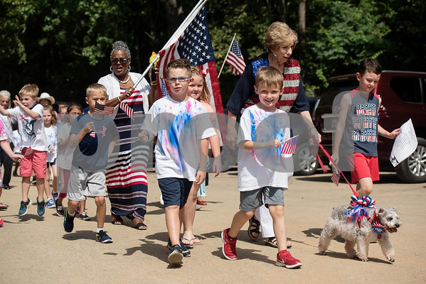Students at Stepping Stone School in Tyler have a Fourth of July parade in their parking lot on Tuesday July 3, 2018.   (Sarah A. Miller/Tyler Morning Telegraph)