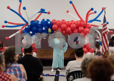 Patsy Crist of Cumby dresses as Lady Liberty for a Fourth of July presentation at Stepping Stone School in Tyler on Tuesday July 3, 2018. Crist is the reigning Ms. Texas Senior Classic queen.  (Sarah A. Miller/Tyler Morning Telegraph)