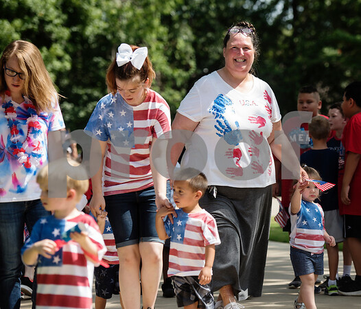 Students at Stepping Stone School in Tyler, including teacher Marci Hamilton, have a Fourth of July parade in their parking lot on Tuesday July 3, 2018.   (Sarah A. Miller/Tyler Morning Telegraph)