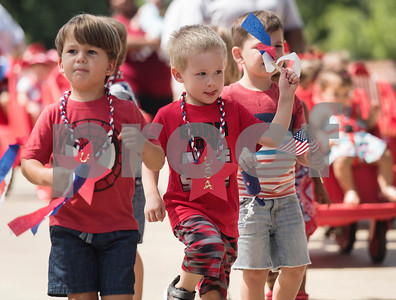 Stepping Stone School students Riordan O'Grady, 3, and Joshua Chambless, 3, march in a Fourth of July parade in the school's parking lot in Tyler on Tuesday July 3, 2018.   (Sarah A. Miller/Tyler Morning Telegraph)