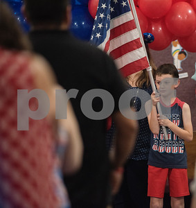 Landon Beaton, 9, helps present the colors at the start of a Fourth of July presentation at Stepping Stone School in Tyler on Tuesday July 3, 2018.   (Sarah A. Miller/Tyler Morning Telegraph)