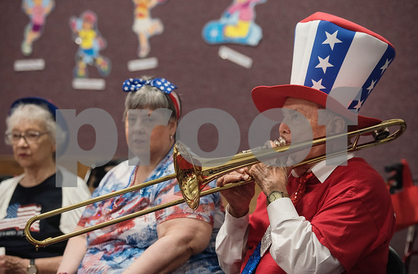 Korean War veteran Bill Burleson of Tyler plays the trombone during a Fourth of July presentation at Stepping Stone School in Tyler on Tuesday July 3, 2018. Residents from Prestige Estates Assisted Living along with women from the Ms. Texas Senior Classic Pageant visited the preschool for a patriotic presentation followed by a student parade at the school.   (Sarah A. Miller/Tyler Morning Telegraph)