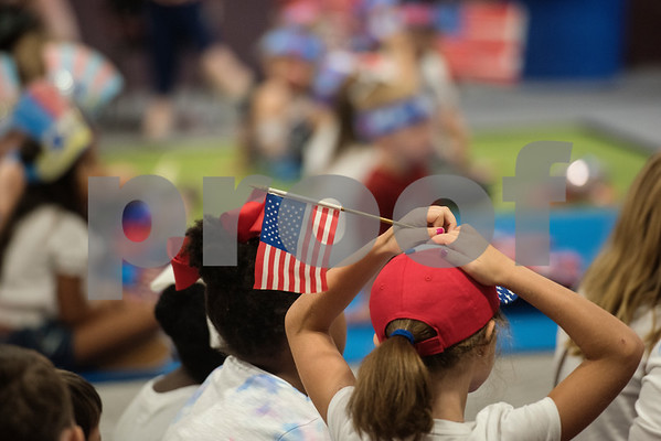 A student holds an American flag during a Fourth of July presentation at Stepping Stone School in Tyler on Tuesday July 3, 2018.   (Sarah A. Miller/Tyler Morning Telegraph)