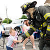 Don Knight   The Herald Bulletin<br /> A member of Richland Township's fire department greets a young boy in the crowd during the Chesterfield 4th of July Parade on Monday.