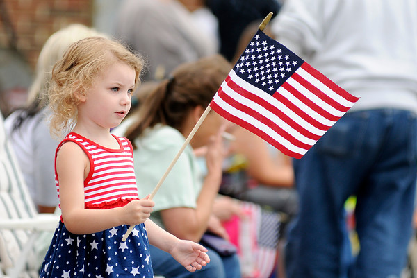 Don Knight   The Herald Bulletin<br /> Kaatje Heck, 4, waves a flag during the Chesterfield 4th of July Parade on Monday.