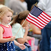 Don Knight | The Herald Bulletin<br /> Kaatje Heck, 4, waves a flag during the Chesterfield 4th of July Parade on Monday.