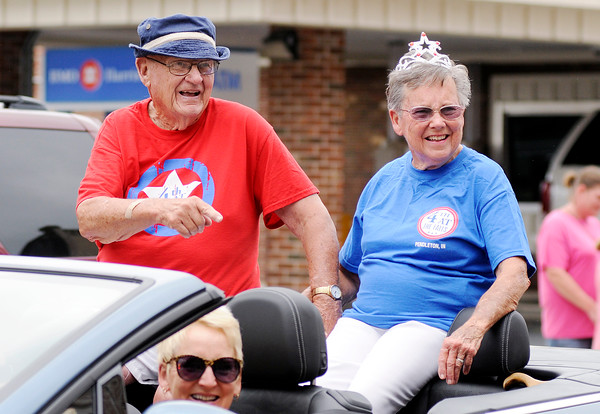 Don Knight | The Herald Bulletin<br /> Becentennial torchbearers Jim and Marilyn Crosley ride in the Pendleton 4th at the Falls Parade on Monday.