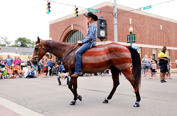 Don Knight | The Herald Bulletin<br /> Shanna Tomlinson decorated her horse Doc like the American Flag during the Pendleton 4th at the Falls Parade on Monday.