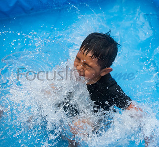Carlo Marquez, 6, splashes down into water from an inflatable bounce house pool slide at his home in Tyler on July 4, 2019.  (Sarah A. Miller/Tyler Morning Telegraph)