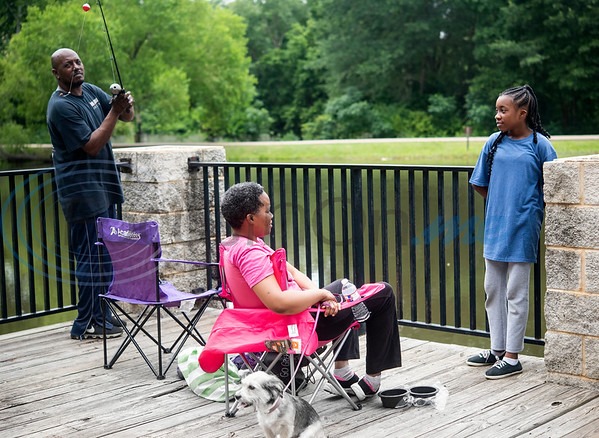Eric Moaning, Schwanda Moaning and Eriunna Moaning, 11, with their dog Princess fish at the pond outside of the Glass Recreation Center in Tyler on July 4, 2019.  (Sarah A. Miller/Tyler Morning Telegraph)
