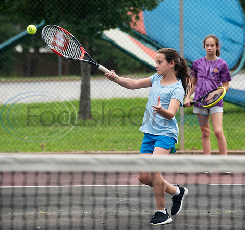 Courtney Reilly, 10, and Cassie Reilly, 11, play tennis at Fun Forest Park in Tyler on July 4, 2019.  (Sarah A. Miller/Tyler Morning Telegraph)