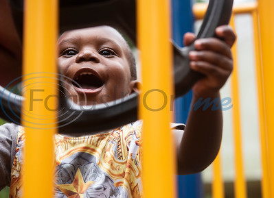 Elijah Simmons, 1, plays with a steering wheel at the playground outside of the Glass Recreation Center on July 4, 2019.  (Sarah A. Miller/Tyler Morning Telegraph)
